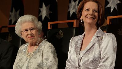 Queen Elizabeth II sits alongside Australia's first female Prime Minister