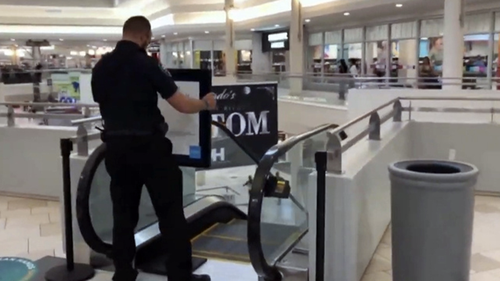 Police are investigating what caused the boy to fall from the escalator.