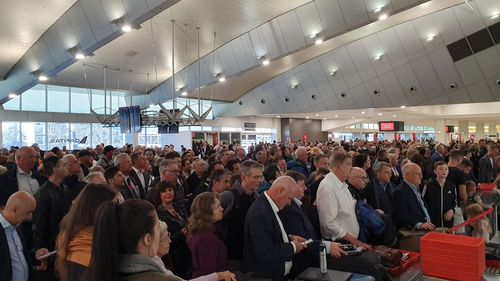 Melbourne Airport's Qantas Terminal has large queues following the evacuation. Picture:John Tomczyk‏