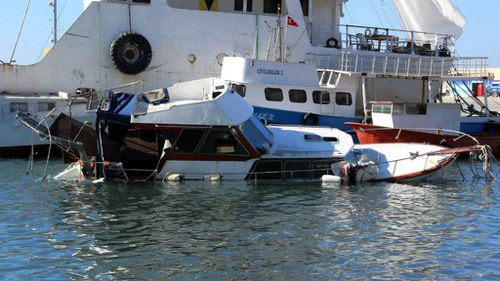 A boat that sunk leaving 14 migrants drown rests in a Turkish port. (AAP)