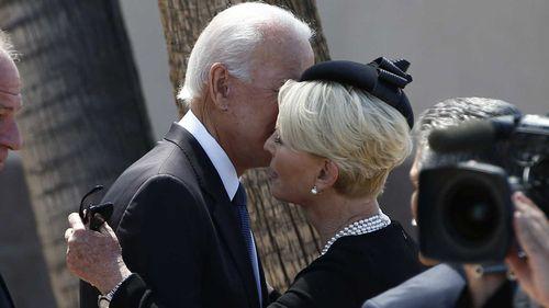 Joe Biden embraces Cindy McCain at her husband John's funeral.