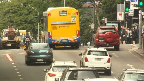 Brisbane commuters are spending longer behind the wheel as average speeds plummet on the city's roads.