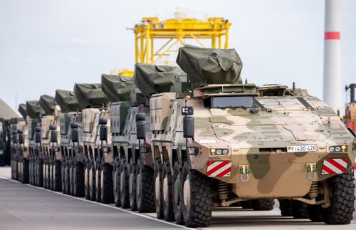 Armoured personnel carriers from the German army bound for the Trident Juncture exercises are parked before being loaded onto ships in the port of  of Emder in Emden, Germany.