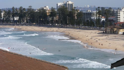 Unconscious man pulled from water at Manly Beach