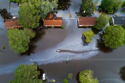 Two people in a canoe paddle through a street that was flooded by Hurricane Florence north of New Bern, North Carolina.