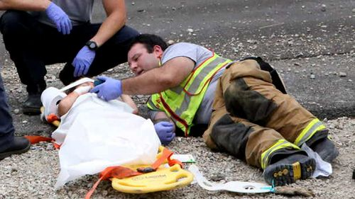 Firefighter comforts young car crash victim by playing 'Happy Feet' on his phone