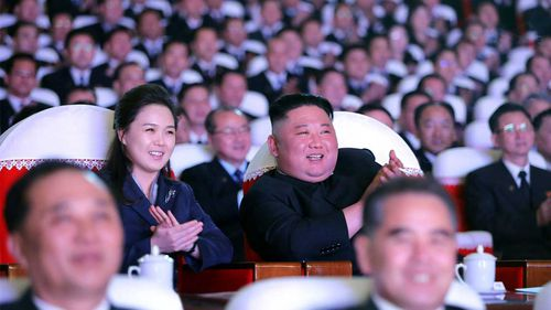 Kim Jong-un and his wife at an event in North Korea.