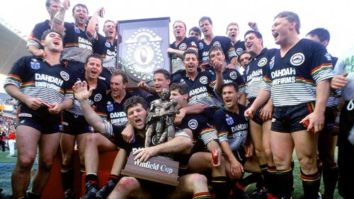 Penrith players celebrate their win in the 1991 grand final.