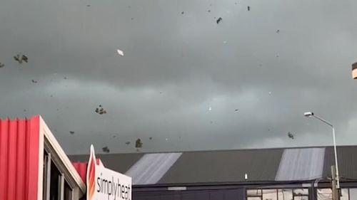 The tornado sent debris hurtling through the air.
