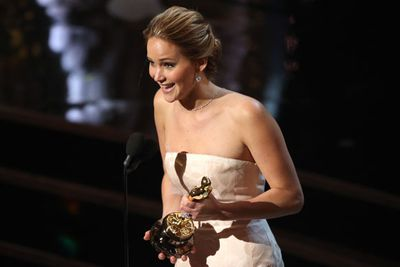 After a nasty spill on the steps to the podium, Jennifer Lawrence recovered in style to accept Best Actress in a Leading Role for Silver Linings Playbook.