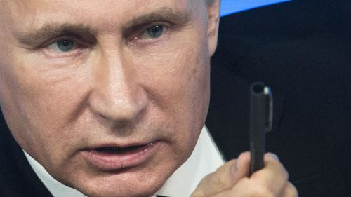 Putin blames West for rouble collapse, promises recovery