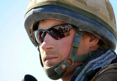 2008. Britain's Prince Harry  sits atop  a military vehicle in the Helmand province, Southern Afghanistan