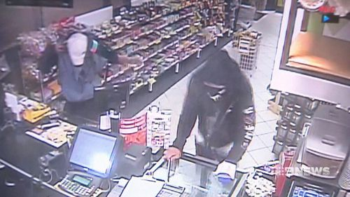 The masked pair told the employee they'd hurt him if he didn't comply with their demands. (9NEWS)