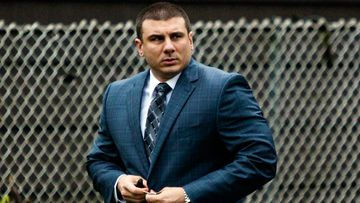 New York City police officer Daniel Pantaleo leaves his house in Staten Island, New York. After five years of investigations and protests, New York City's police commissioner fired Pantaleo, an officer involved in the 2014 chokehold death of an unarmed black man whose dying cries of