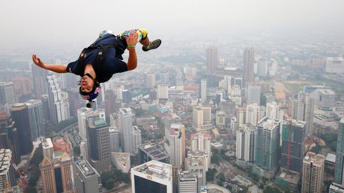 In this 2013 file photo, base jumper Vince Reffet, leaps from the 300-metre open deck of the Malaysia's landmark Kuala Lumpur Tower.