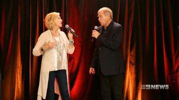 VIDEO: Olivia Newton-John and John Farnham give cancer patients surprise Christmas treat