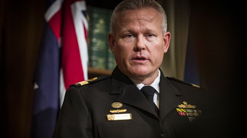 Commodore Eric Young speaks to the media on his new role as the new head of the Vaccine Operations Centre.