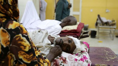 Sudanese people wait to receive treatment at hospital as several doctors join a 'Civil Disobedience' campaign, in Omdurman, near Khartoum, Sudan.