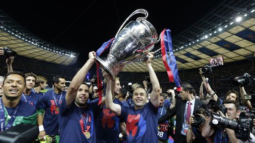 Jubilant Barcelona players with the Champions League trophy. (AAP)