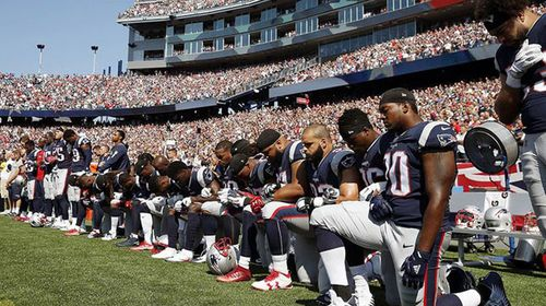 New England Patriots players kneel during the national anthem before an NFL football game against the Houston Texans. (AP)