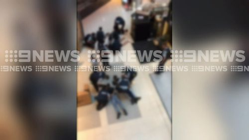 Five men were arrested after carrying replica firearms into Chatswood Westfield this evening.