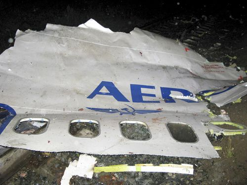 In this photo released by Press Service of Russian Emergencies Ministry in Perm region a fuselage piece of a Boeing-737-500 with the company's name Aeroflot, partly seen, lies at the crash site on the outskirts of the Ural Mountains city, early Sunday, Sept. 14, 2008, shortly after the crash. The Boeing-737-500 passenger jet, which was operated by an Aeroflot subsidiary, traveling from Moscow crashed as it was preparing to land early Sunday, killing all 88 people aboard, officials said Sunday. (AP Photo/Press Service of Russian Emergencies Ministry in Perm region, HO)