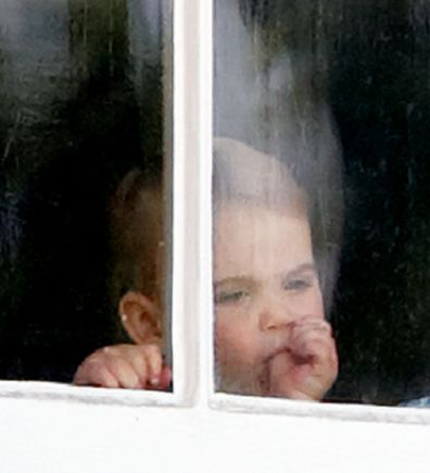 Prince Louis was seen sucking his thumb through a window of Buckingham Palace.