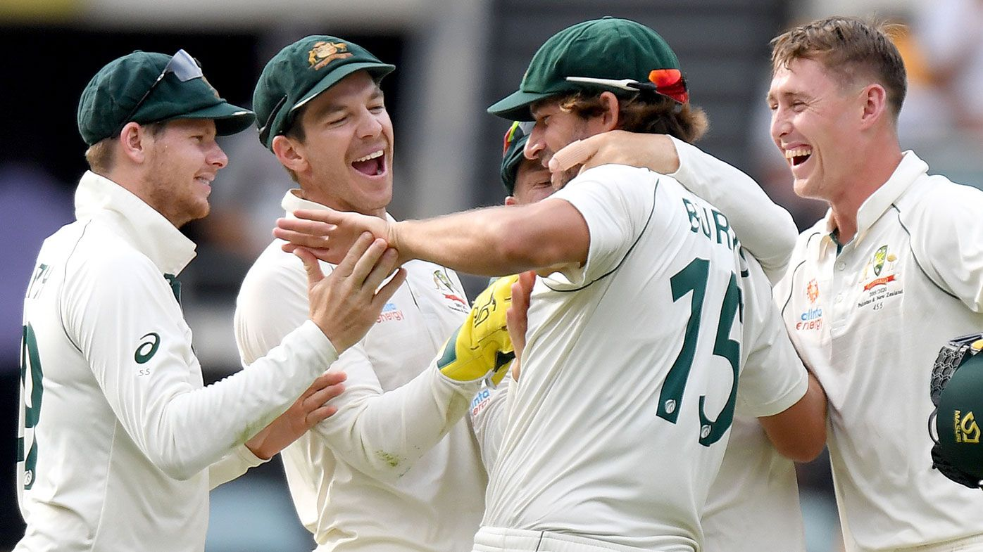 Australian players celebrate a wicket during the first Test against Pakistan.