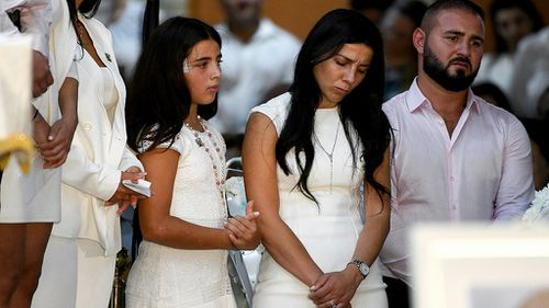 Leila Geagea (middle) and daughter (left) are seen during the funeral for her three children.