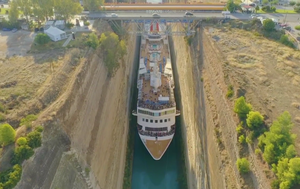 Hair-raising photos reveal huge cruise liner squeezing through the Corinth Canal