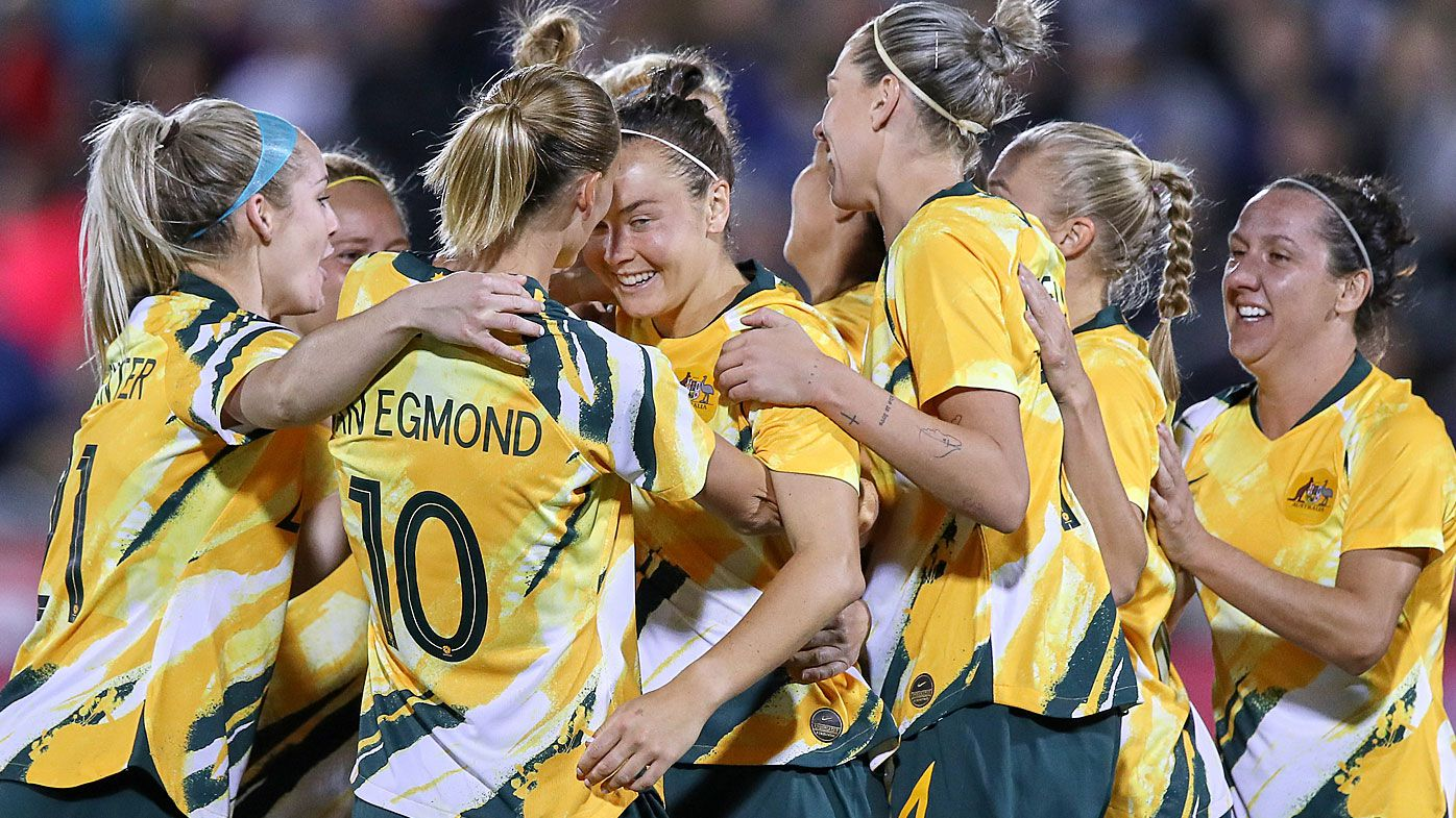 Australia forward Caitlin Foord (9) celebrates with Australia midfielder Emily Van Egmond (10) and teammates after scoring a goal