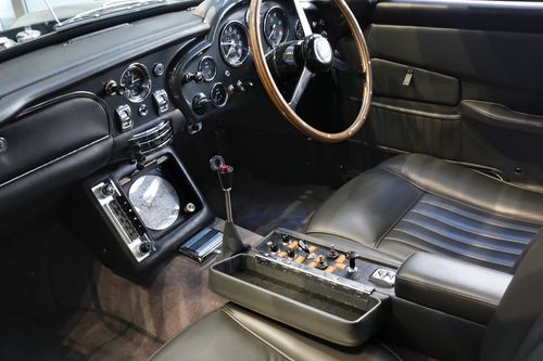 A navigation system and control panel for defense accessories are installed beside the drivers seat of a James Bond 1965 Aston Martin DB5, at Sotheby's in New York, Monday, July 29, 2019.