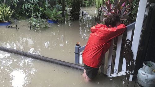 Amelia Rankin sobs as she returns to her flooded Townsville home.