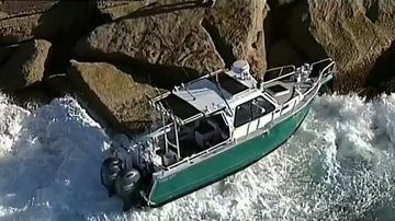 Boat washes onto rocks at Maroubra