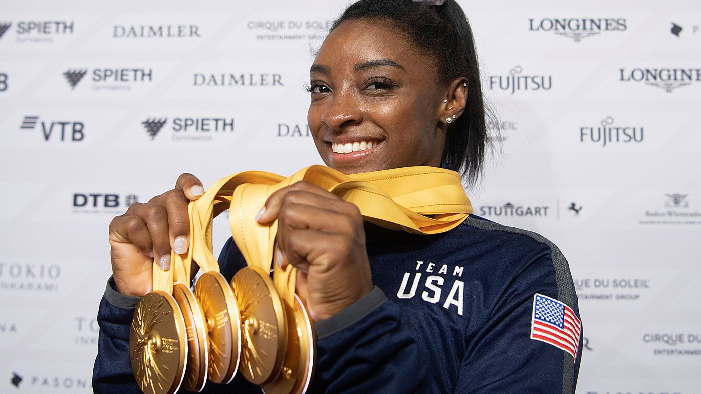 Simone Biles of the United States shows her five gold medals at the Gymnastics World Championships in Stuttgart
