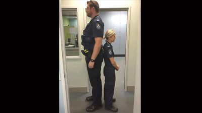 "A photo of an exceptionally tall Cairns policeman standing next to his pocket rocket colleague has inspired ""odd couples"" around the world to share their stories.  A ninemsn Facebook post from last week showing a picture of Constables John and Monique standing back-to-back has now reached close to 20 million people and been liked more than 162,000 times.   Delightfully mismatched partners, colleagues in hospitals, schools and the army are among the photos flooding in.  Click through this gallery to see some of the best."