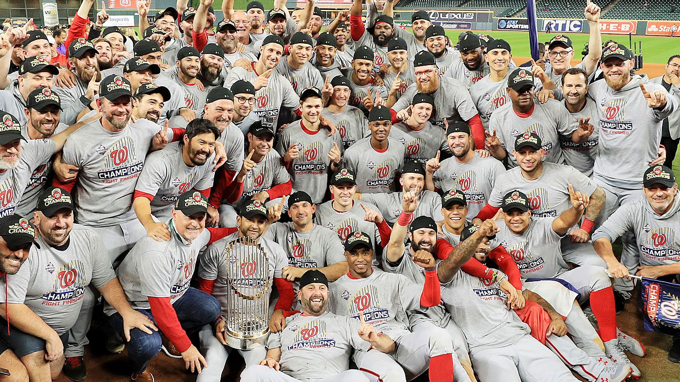 The Washington Nationals pose for a team photo as they celebrate after defeating the Houston Astros in Game Seven