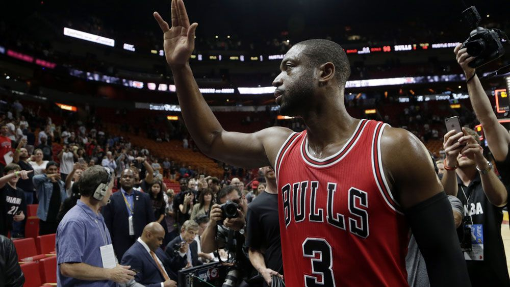 Dwayne Wade greets fans from his former team the Miami Heat after the Bulls three point victory.(AAP)