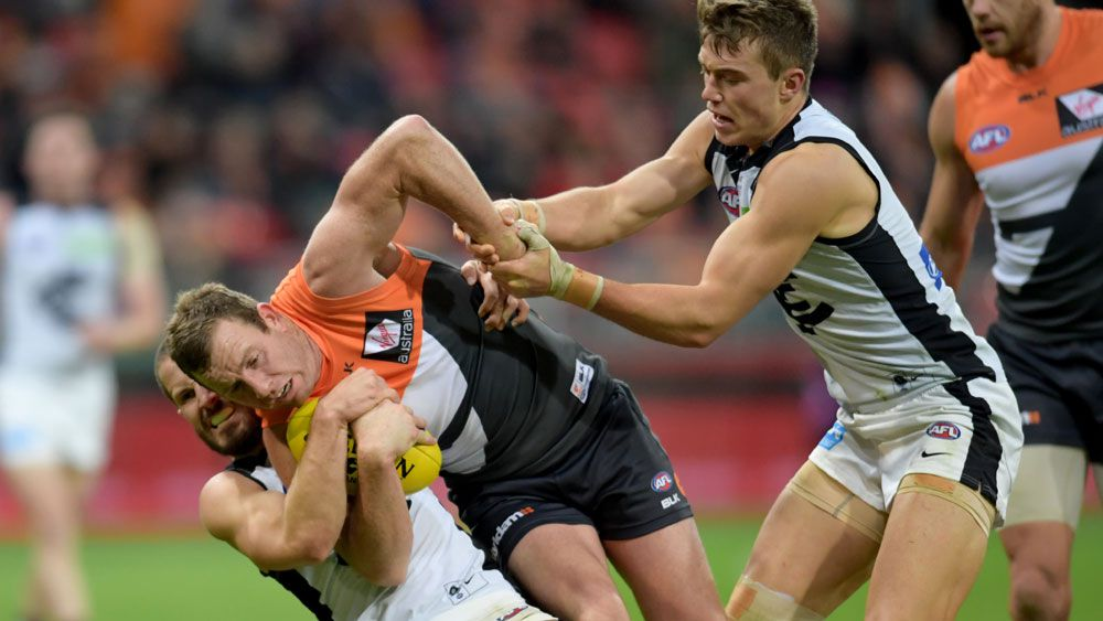 GWS Steve Johnson is tackled (AAP)