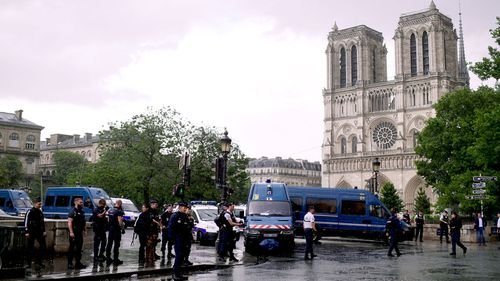 Emergency services swarm on Notre Dame cathedral in central Paris after a man is shot. (AFP)