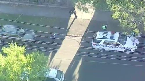 Police at the scene in Box Hill. (9NEWS)