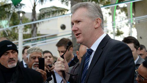 Labor MP Tony Burke speaks to Muslims outside Lakemba Mosque in Sydney. (Getty)