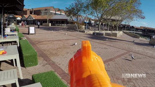 Hillary's 3Sheets restaurant has resorted to equipping customers with water pistols. (9NEWS)