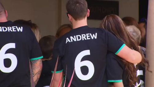 Mourners wore soccer shirts with Andrew's name on the back.