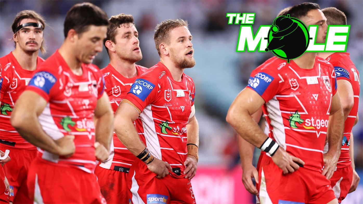 Dragons players react after conceding a try.