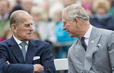 Prince Philip, Duke of Edinburgh and Prince Charles, Prince of Wales attend the unveiling of a statue of Queen Elizabeth The Queen Mother