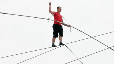 Wallenda successfully walked 1300 feet along the wire above a beach in Atlantic City while about 100 feet above the ground. (AP Photo/The Press of Atlantic City, Sean Fitzgerald)