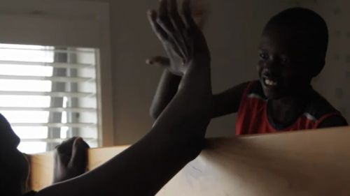 The new ad shows a family of South Sudanese extraction getting ready for school. (Victorian Multicultural Commission)
