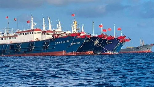 Chinese vessels are moored at Whitsun Reef, South China Sea.