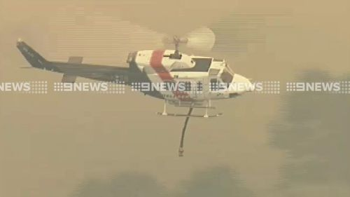 Water bombing aircraft are on scene. (9NEWS)